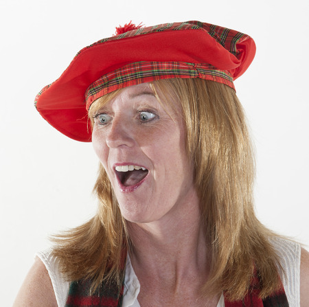 tammy: Woman wearing Tam o Shanter scottish hat