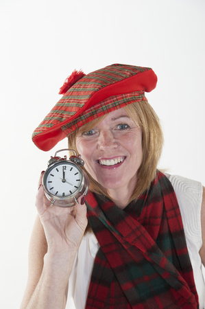 tammy: Woman celebrating the New Year in tartan hat