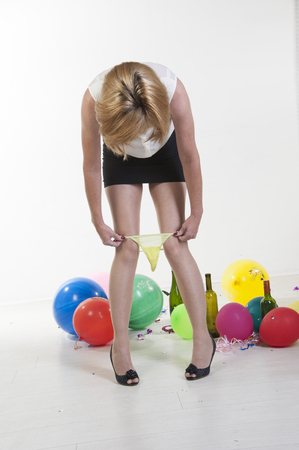 Woman removing underwear at office party photo
