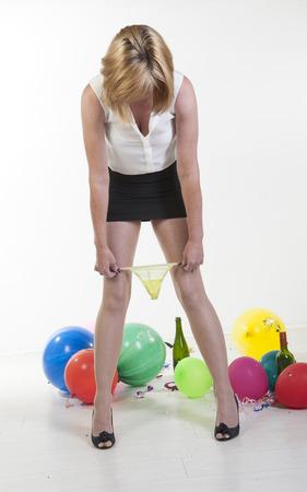 Vrouw het verwijderen van ondergoed op het kantoor partij Stockfoto - 22865713