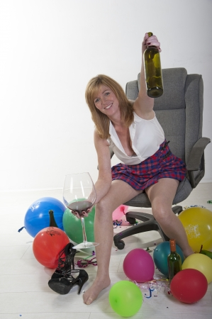 Female party goer drinking wine photo