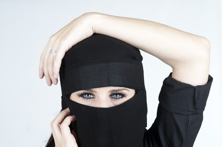 Young woman wearing a Niqub Stock Photo - 23024281