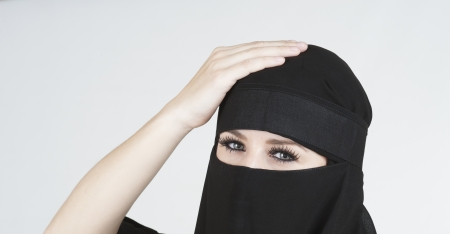 Young woman wearing a Niqub Stock Photo - 23024315