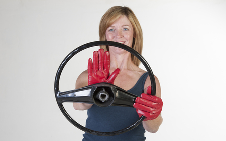 honking: Woman driver at the wheel using horn