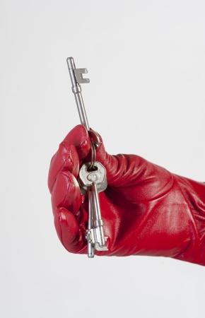 doorkey: Mazzo di chiavi in ??una donna s mano guantata