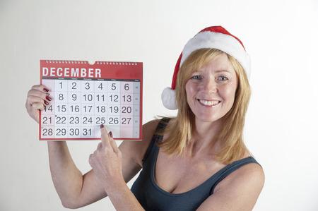 santa s helper: Santa helper pointing at Christmas Day