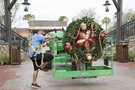 Erecting large Christmas decorations using a platform lift
