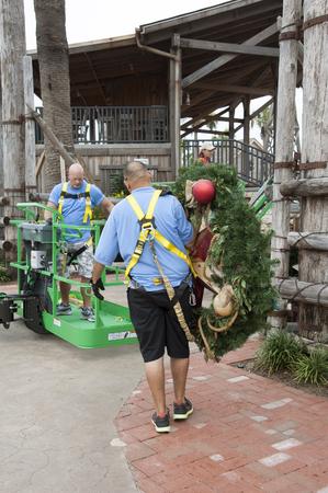 erecting: Erecting large Christmas decorations using a platform lift