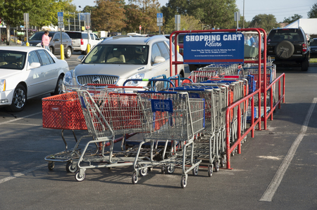 Shopping cart return area in a supermarket car park Editorial