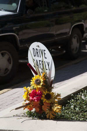 drive safely: Road accident site Flowers in memory