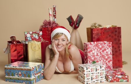 mrs: Mrs Santa with Christmas gifts Stock Photo