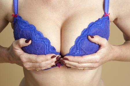 Woman adjusting her bra Stock Photo