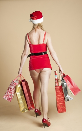 Mrs Santa and her Christmas shopping Stock Photo