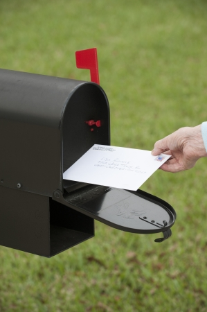US mail box with collection flag raised Stock Photo