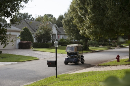 Urban housing estate and golf cart Florida USA