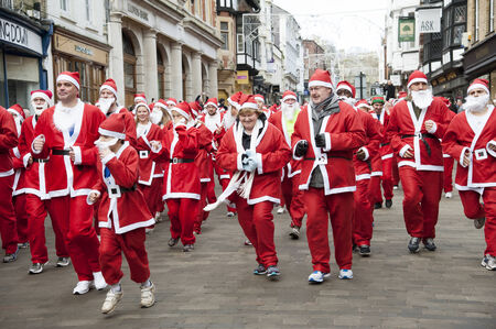 Santa fun run around Winchester city in aid of Naomi House   Jacksplace a children Editorial