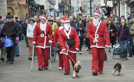 Tail enders with their dogs on the Santa fun run around Winchester city in aid of Naomi House   Jacksplace a children