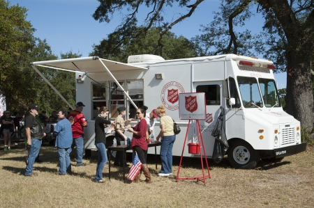 food industry: Salvation Army Emergency Disaster Services truck serving food on Veterans Day Pensacola Fl USA Editorial