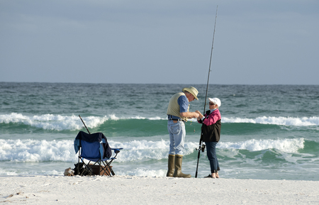 Elderly couple fishing on the beach Panhandle Florida USA