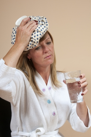 sufferer: Woman using an icepack on her head