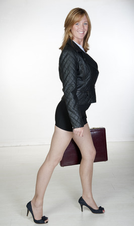 Woman wearing black carrying a briefcase Stock Photo