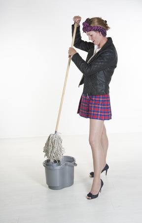 Cleaner lady with bucket squeezing mop photo