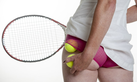 knickers: Female tennis player putting balls into her knickers