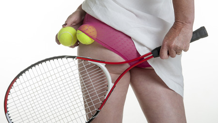 raquet: Female tennis player putting balls into her knickers
