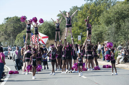 squad: Skys the Limit cheerleaders squad seen on Veterans Day parade Pensacola Florida USA