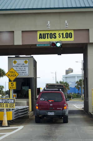 toll: Pay station on toll road at Pensacola Beach Florida USA