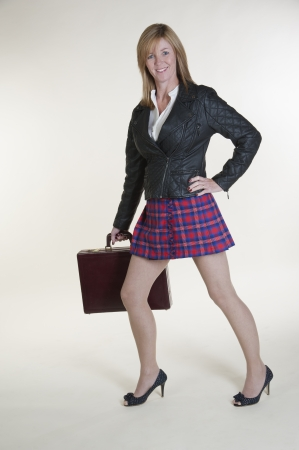Woman wearing a short tartan skirt and black jacket photo
