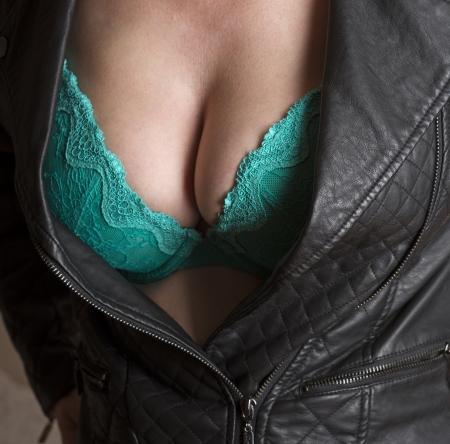 Woman wearing black jacket and green bra Stock Photo