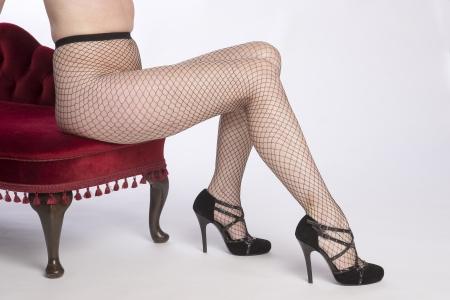 fishnet tights: Woman wearing black fishnet tights
