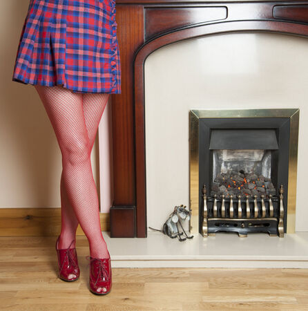 fishnet tights: Woman in short skirt with red fishnet tights