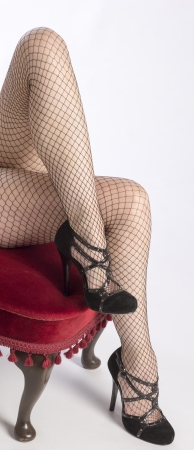 fishnet tights: Woman with long legs wearing black fishnet tights Stock Photo