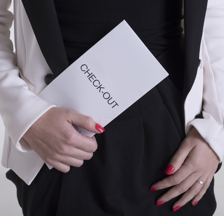 check out: Hotel guest with check out document Stock Photo