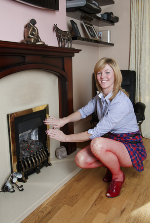 Woman warming her hands in front of a fire photo