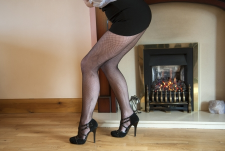 fishnet tights: Woman wear black fishnet tights by the fire