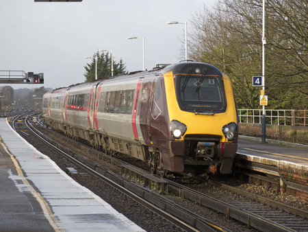Cross Country passenger train approaching Basingstoke Station Hampshire UK
