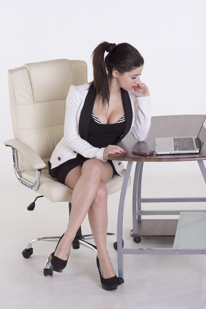 Young secretary sitting office chair