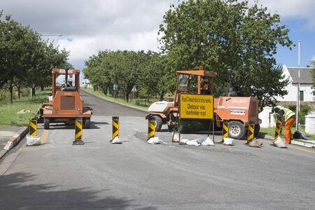 resurfacing: Road closed for resurfacing Contractors vehicles