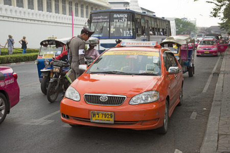 traffic cop: Traffic cop talking to a Bangkok taxi driver Thailand Editorial