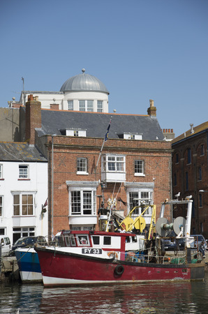 famous industries: Waterfront with fishing boats on the quay at Weymouth Dorset England UK Editorial