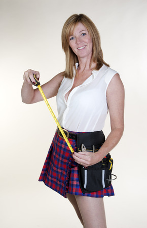 centimetres: Woman using a tape measure Stock Photo
