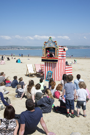 children's show: Punch and Judy entertainment on the beach at Weymouth Dorset UK Editorial