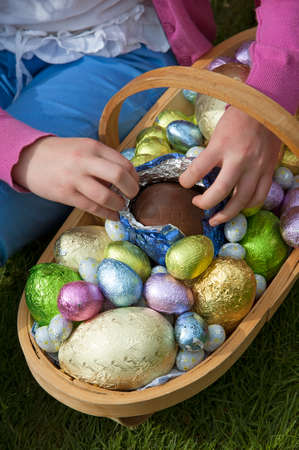 Easter eggs in a garden trug having been collected in a Hunt the eggs competition photo