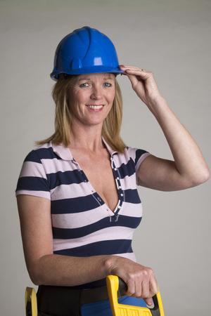 tradesperson: Female tradesperson wearing a hardhat Stock Photo