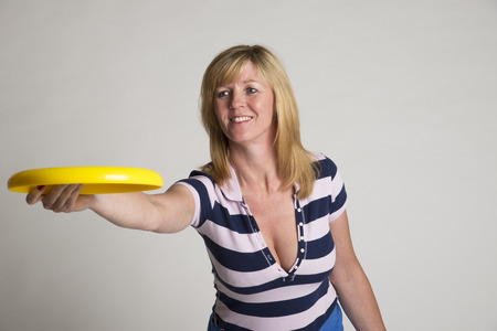 frisbee: Woman throwing a frisbee disc