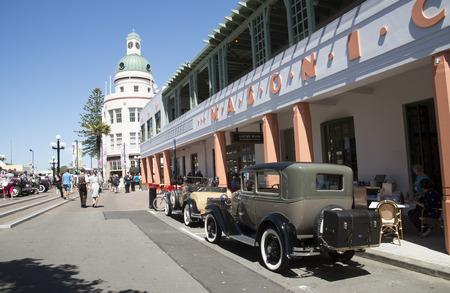 Classic vintage cars outside the Masonic Hotel in the art deco town of Napier New Zealand Editoriali