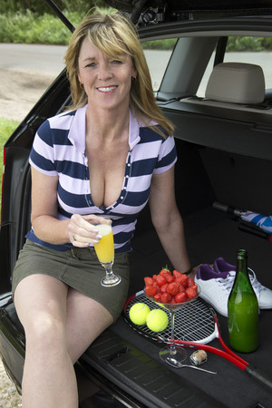 Woman drinking a glass of bubbly